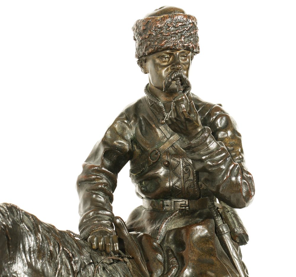 a bronze statue of a Cossack hunter on horse